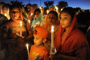 (above) Sikhs participating in a vigil following the Wisconsin gurdwara massacre in 2012